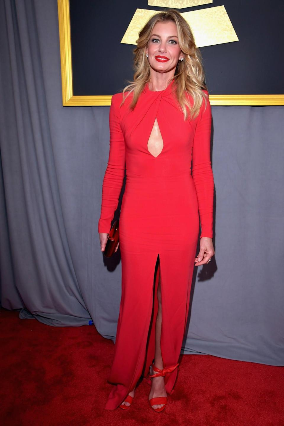 Faith Hill wore a sleek red gown on to the 2017 Grammy Awards. (Photo: Getty Images)