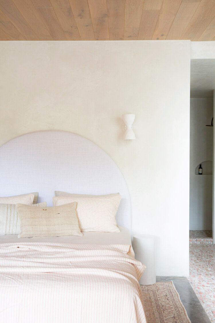 <p>If you're worried that a wood ceiling would make the room feel too dark, think again. As seen in this bedroom by Tamsin Johnson, the light wood ceiling actually grounds the bedroom, giving the light pink, beige, and cream color scheme a more inviting and finished look. </p>