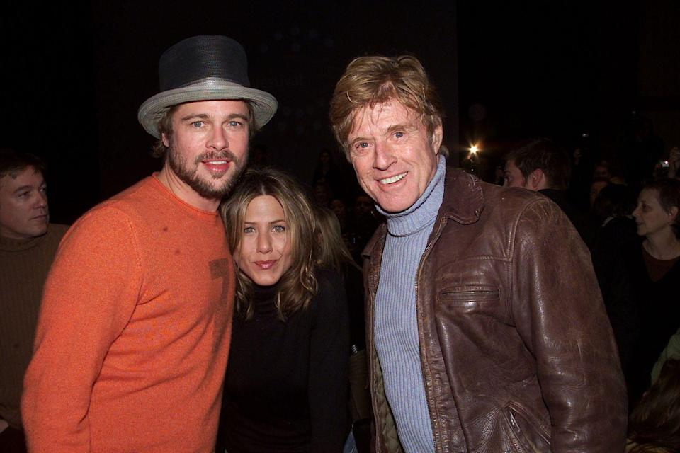 <p>Pitt and his wife, Aniston, chat with his <em>Spy Game </em>costar Robert Redford at the Sundance Film Festival.  </p>