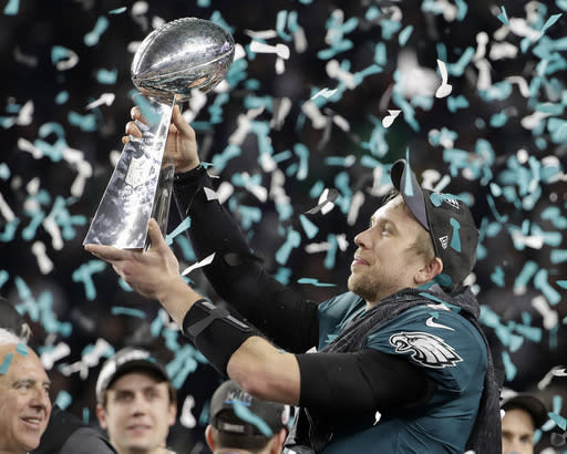 The Philadelphia Eagles' Nick Foles holds up the Vince Lombardi Trophy after winning Super Bowl LII against the New England Patriots. (AP)