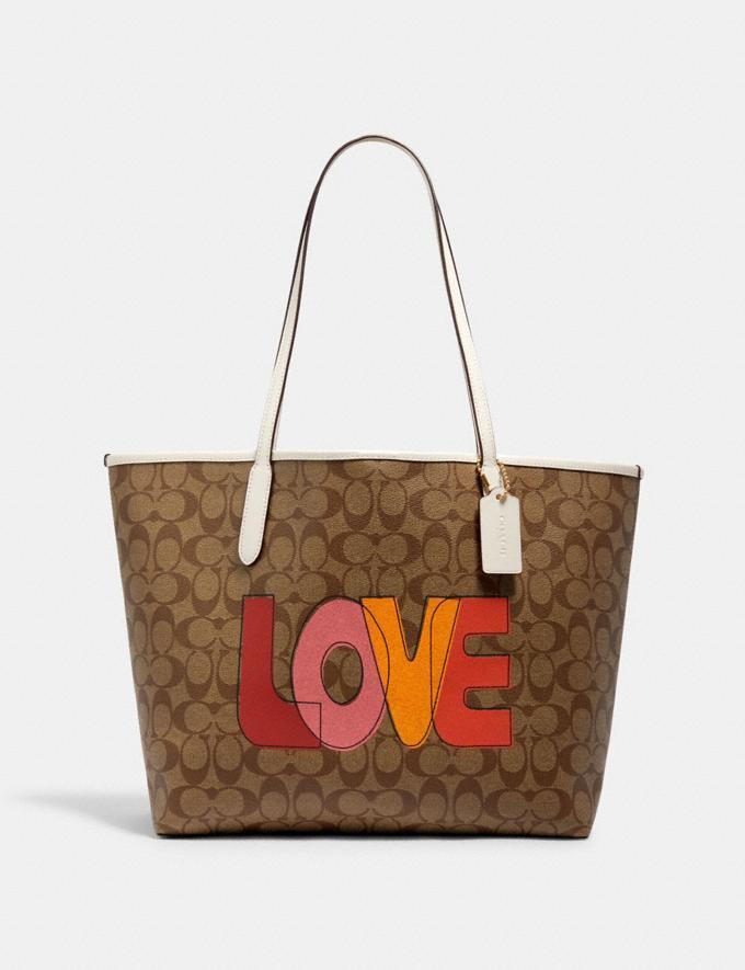 City Tote In Signature Canvas With Love Print. Image via Coach Outlet.