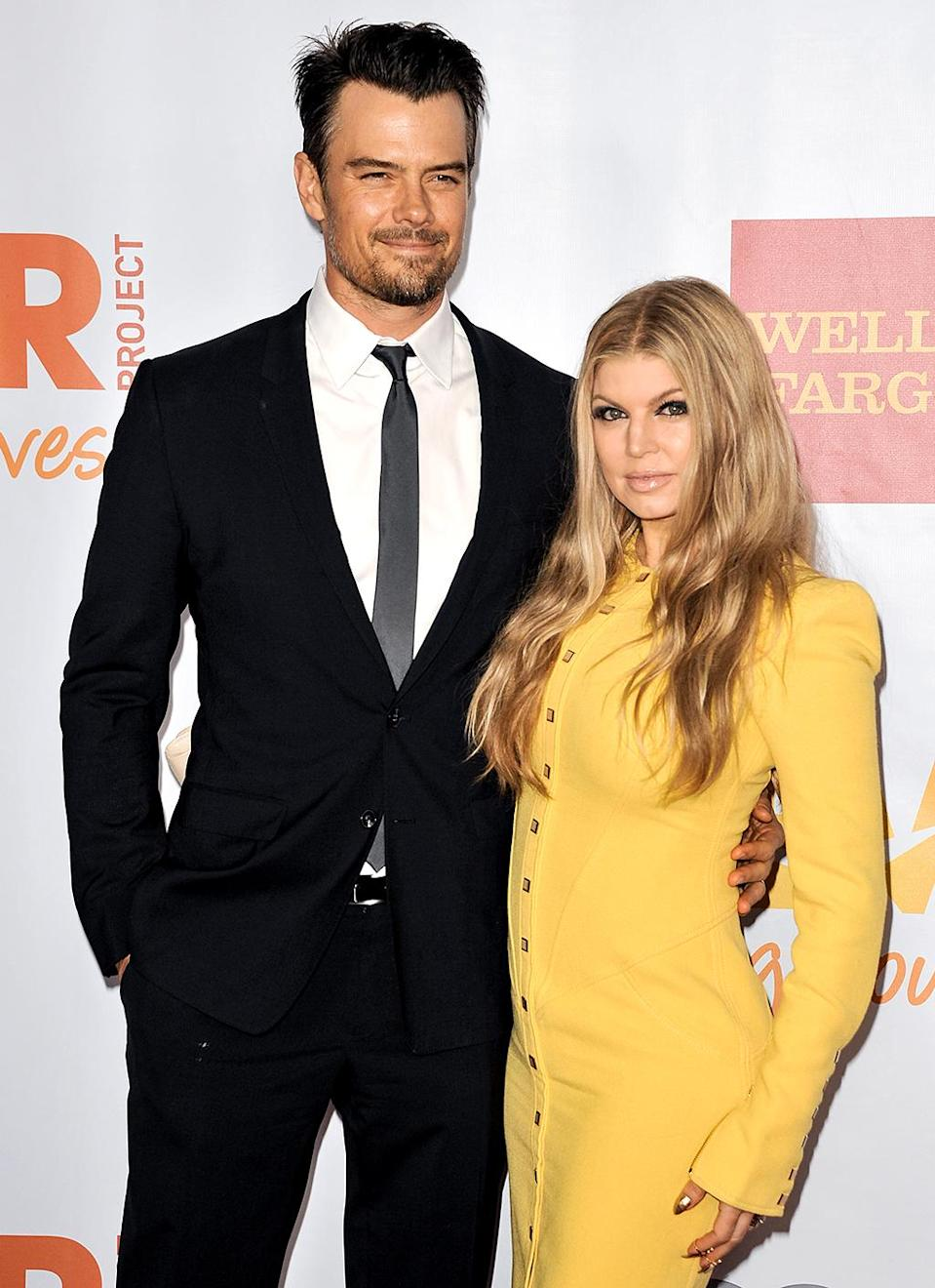 """<p>OK, so this isn't exactly <i>cute</i>, but it's certainly an unforgettable meet-up story. Former soap star Josh was starring in the short-lived show <i>Las Vegas</i> and was asked by <i>InStyle</i> to name his celebrity crush. He said the Black Eyed Peas singer and also detailed a sexy dream he had had about her. Fergie and her band later made an appearance on <i>Las Vegas</i>, and on the set she called him out. """"'I read you had a dream,'"""" she later told <i>Playboy</i>. """"I asked, 'Was it good?' He said it was. So we hit it off."""" They married in 2009 and welcomed son Axl in 2013. (Photo: Richard Shotwell/Invision/AP) </p>"""