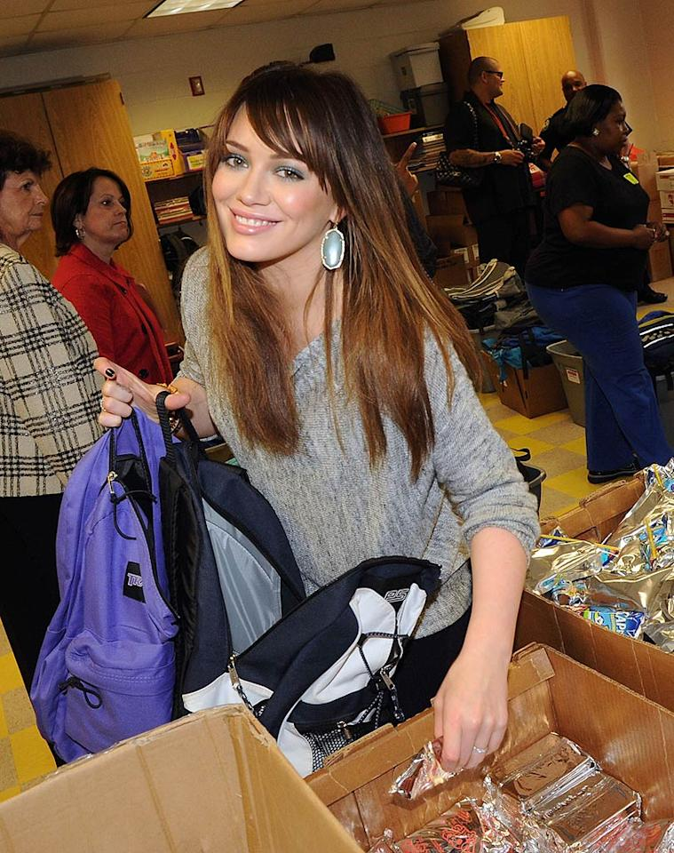 """Hilary Duff -- sporting a new 'do -- took time out to do a little good by supporting the """"Blessings in a Backpack"""" program and handing out backpacks filled with food at an elementary school in Atlanta, Georgia. Rick Diamond/Getty Images - <a href=""""http://www.gettyimages.com/"""" target=""""new"""">GettyImages.com</a> - March 21, 2011"""