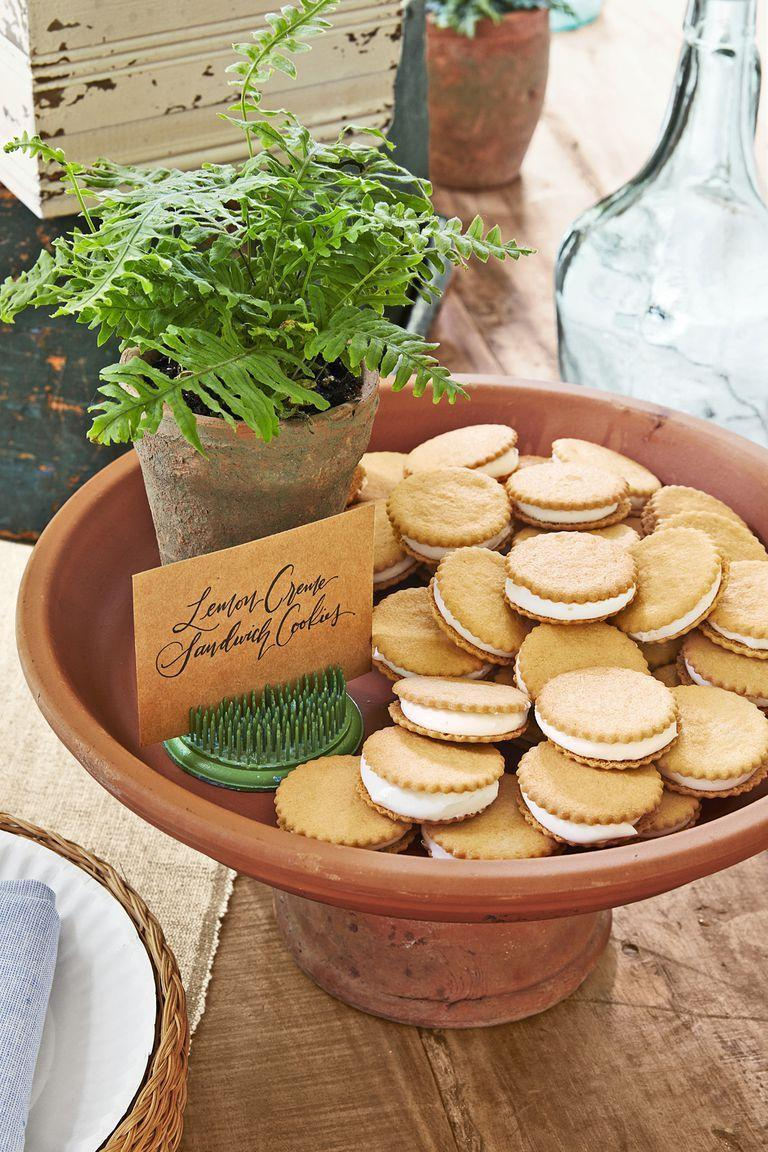 """<p>This dainty dessert is so easy thanks to store-bought lemon cookies.</p><p><strong><a href=""""https://www.countryliving.com/food-drinks/a22667889/lemon-creme-sandwich-cookies-recipe/"""" rel=""""nofollow noopener"""" target=""""_blank"""" data-ylk=""""slk:Get the recipe"""" class=""""link rapid-noclick-resp"""">Get the recipe</a>.</strong></p>"""