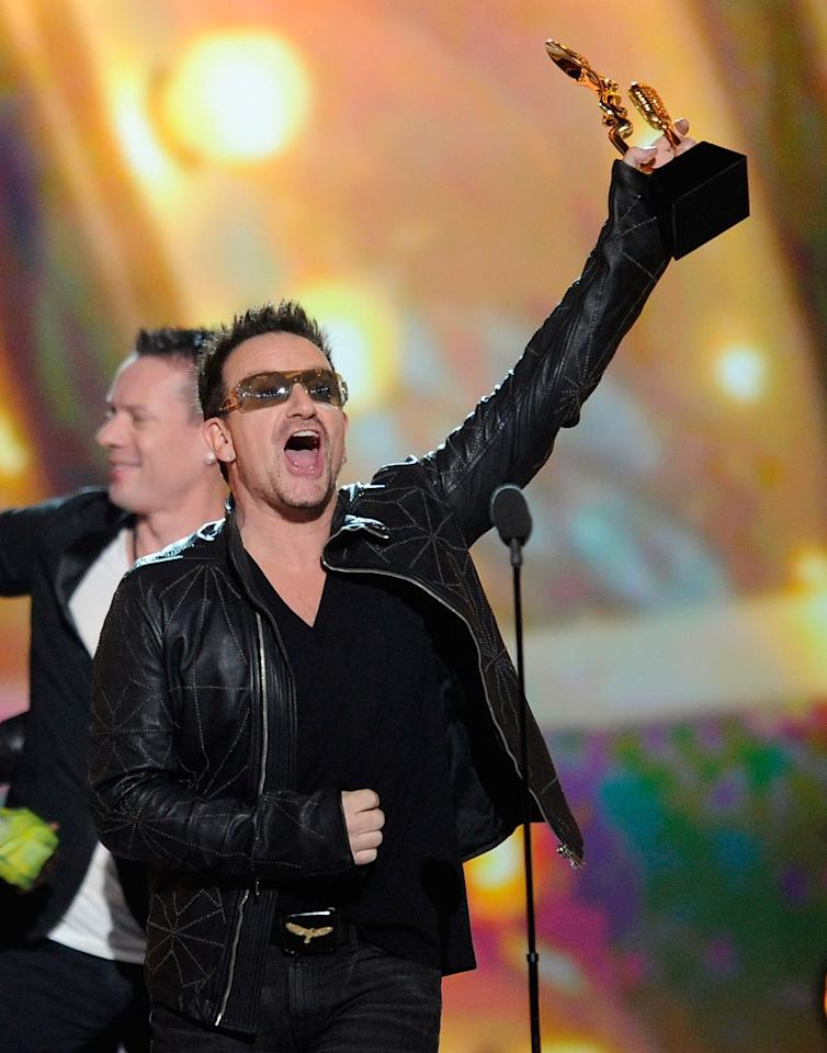 LAS VEGAS, NV - MAY 22:  Singer Bono of U2 accepts the Top Touring Artist award onstage during the 2011 Billboard Music Awards at the MGM Grand Garden Arena May 22, 2011 in Las Vegas, Nevada.  (Photo by Ethan Miller/Getty Images for ABC)