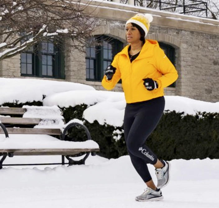 Image: Kim Backey running in Buffalo snow (Courtesy Will Holton)