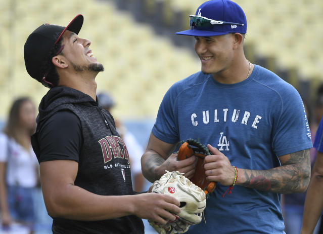 "Jon Jay, left, laughs with Manny Machado last season. Now Jay is joining the <a class=""link rapid-noclick-resp"" href=""/mlb/teams/chw"" data-ylk=""slk:White Sox"">White Sox</a>, who are also wooing Machado. (Photo by John McCoy/Getty Images)"