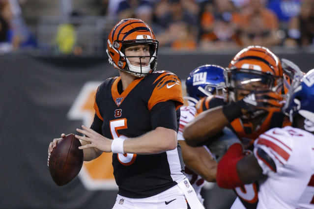 FILE - In this Aug. 22, 2019, file photo, Cincinnati Bengals quarterback Ryan Finley (5) looks to pass during the first half of an NFL preseason football game against the New York Giants, in Cincinnati. The winless Bengals benched Andy Dalton heading into their bye week, ending his nine-season run as starter so they can start developing rookie Ryan Finley as his potential long-term replacement. The move came two days after a 24-10 loss to the Rams in London left Cincinnati 0-8 for the first time in 11 years. (AP Photo/Frank Victores, File)