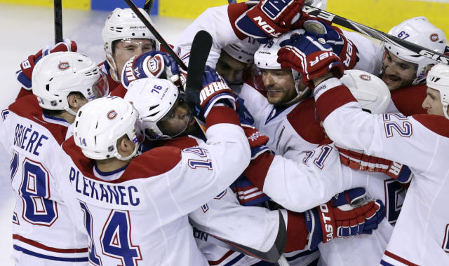 Montreal Canadiens defenseman P.K. Subban (76) is surrounded by teammates after scoring the game-winning goal off Boston Bruins goalie Tuukka Rask during the second overtime period of Game 1 in the second round of the Stanley Cup playoffs in Boston, Thursday, May 1, 2014. The Canadiens won 4-3. (AP Photo/Charles Krupa)