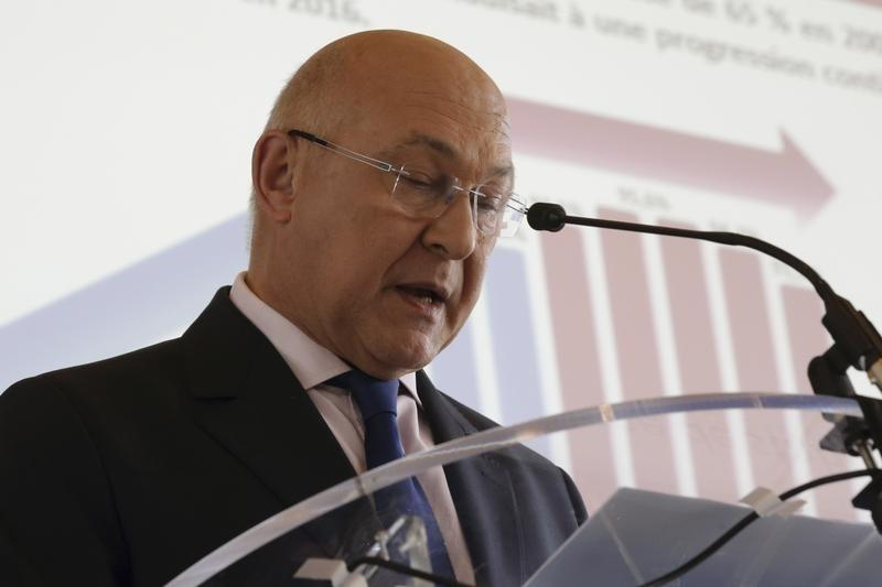 French Finance minister Sapin attends a press conference at the Ministry in Paris