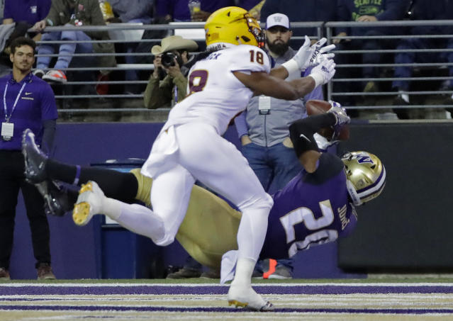 Washington wide receiver Ty Jones falls backward as he catches a pass for a touchdown, while Arizona State cornerback Langston Frederick (18) defends during the first half of an NCAA college football game, Saturday, Sept. 22, 2018, in Seattle. (AP Photo/Ted S. Warren)