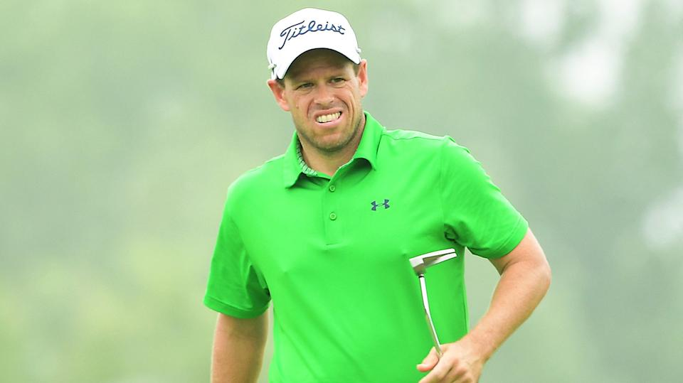 Andrew Martin (pictured) walking with his putter.