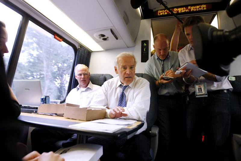 FILE - In this Sept. 16, 2008 file photo, then-Democratic vice presidential candidate Sen. Joe Biden, D-Del. mingles with passengers aboard the Amtrak Acela train from Washington to Wilmington, Del. Warning to Amtrak from Mitt Romney and Republicans: You're on your own. The platform Republicans adopted at their convention includes a call for full privatization and an end to subsidies for the nation's passenger rail operator, which gobbled up almost $1.5 billion in federal funds last year. (AP Photo/Gerald Herbert, File)