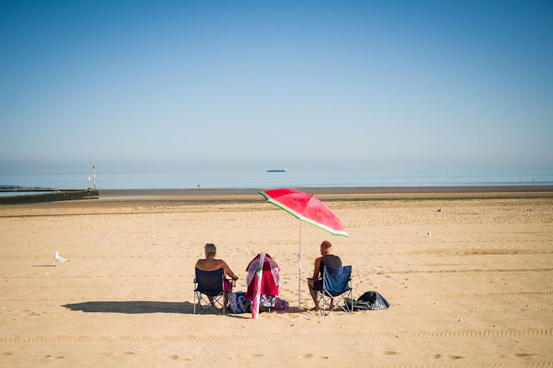 A couple stake an early claim on the best spot on the beach on August 07, 2020 in Margate (Photo: Leon Neal via Getty Images)