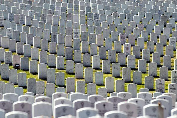 Rows of headstones stretch on at Arlington National Cemetery. The military says it will check all graves in the wake of a scandal over mislabeling and management problems. Full story