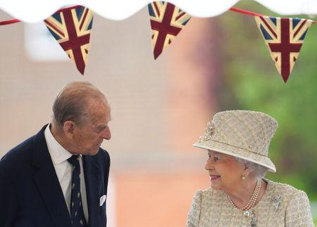 FILE PHOTO: Britain's Queen Elizabeth and Prince Philip visit Pangbourne College near Reading, May 9, 2017. REUTERS/Toby Melville/File Photo