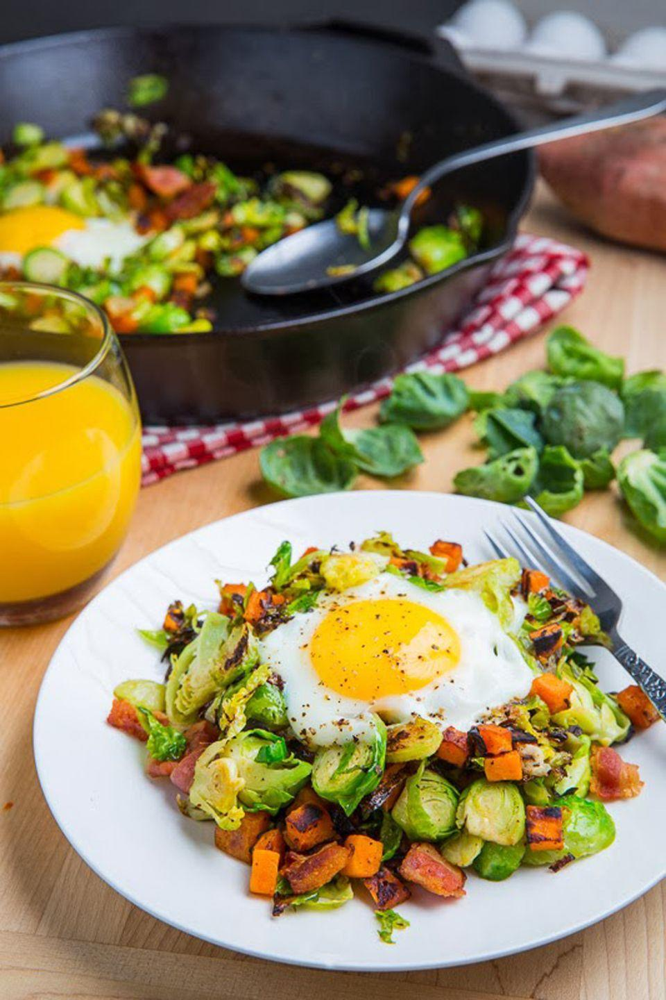 """<p>Don't let your Thanksgiving veggies go to waste! Simply add them to this hash recipe to create a breakfast dish with color.</p><p><strong>Get the recipe at <a href=""""http://www.closetcooking.com/2013/11/brussels-sprout-hash-with-sweet-potato.html"""" rel=""""nofollow noopener"""" target=""""_blank"""" data-ylk=""""slk:Closet Cooking"""" class=""""link rapid-noclick-resp"""">Closet Cooking</a>.</strong></p>"""