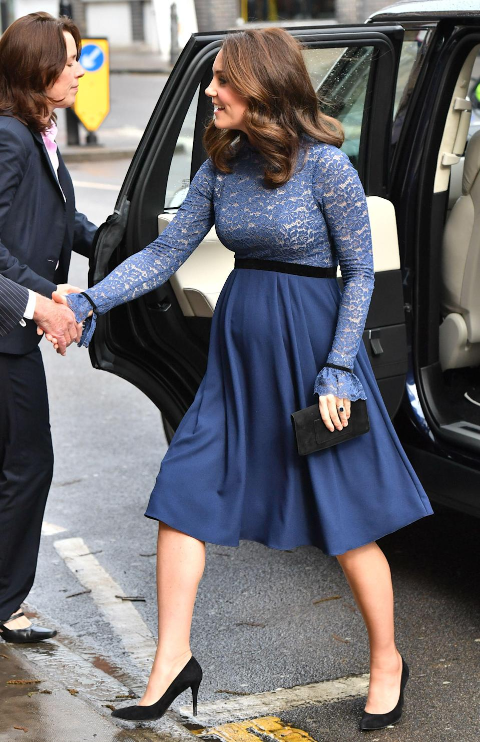 <p>Once again proving that she's the master of maternity dressing, the Duchess of Cambridge chose a knee-length blue dress for a London outing this weekend (Rex features) </p>