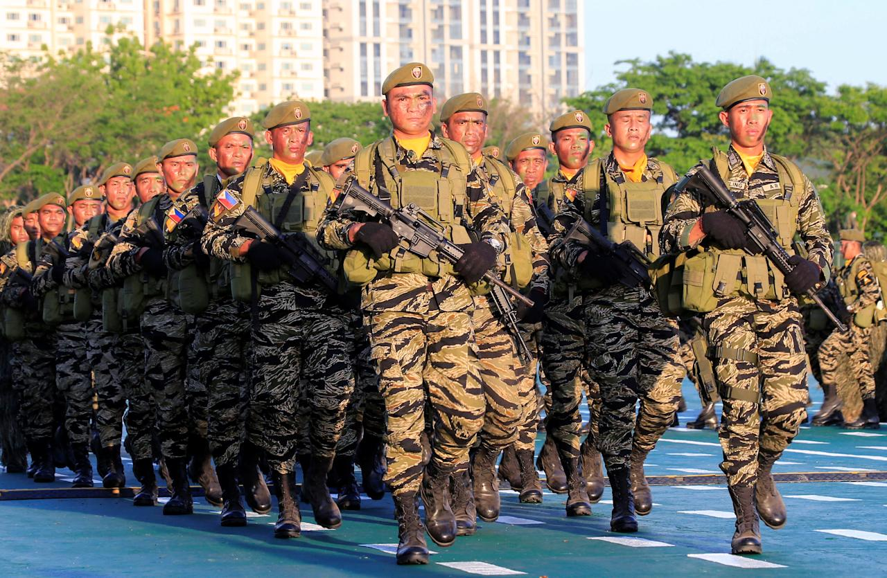 Soldiers march during the 121st founding anniversary of the Philippine Army (PA) at Taguig city, Metro Manila, Philippines March 20, 2018. REUTERS/Romeo Ranoco