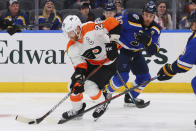 Philadelphia Flyers center Claude Giroux (28) controls the puck against St. Louis Blues center Ryan O'Reilly (90) during the first period of an NHL hockey game Wednesday, Jan. 15, 2020 in St. Louis. (AP Photo/Dilip Vishwanat)