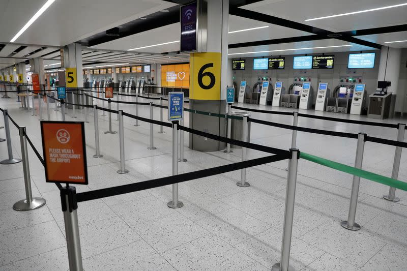 An almost empty check-in area is seen at Gatwick Airport, amid the coronavirus disease (COVID-19) outbreak, in Crawley