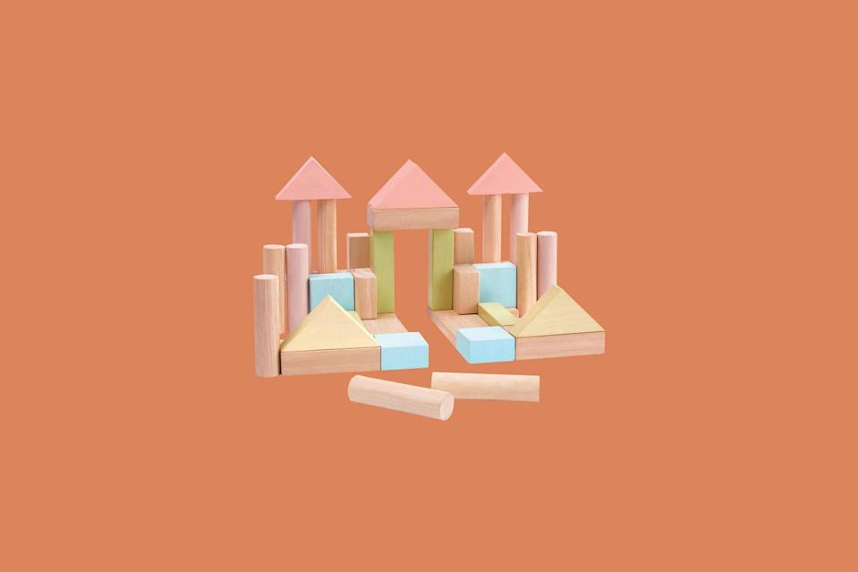 """<p>To stimulate the baby's creativity and imagination, this starter set contains 40 wooden blocks in 6 shapes (18 pastel color pieces and 22 natural wood color pieces). They'll practice stacking the pieces one atop the other and, eventually, build their own worlds.</p> <p><strong><em>Shop Now:</em></strong><em> Plan Toys 40-Piece Block Set, $30, <a href=""""https://www.amazon.com/PlanToys-5507-40-Unit-Blocks/dp/B07BTN3N7Y/ref=as_li_ss_tl?ie=UTF8&linkCode=ll1&tag=msllifebabyshowerinaboxdeliveryachurchilljuly20-20&linkId=1a72a5f3b81f781af8e2bde8e4ae6408&language=en_US"""" rel=""""nofollow noopener"""" target=""""_blank"""" data-ylk=""""slk:amazon.com"""" class=""""link rapid-noclick-resp"""">amazon.com</a></em><em>.</em></p>"""