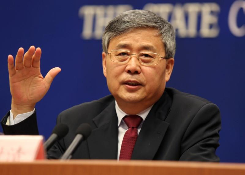 FILE PHOTO: Guo Shuqing, China's newly appointed banking regulator, attends a news conference ahead of China's parliament in Beijing