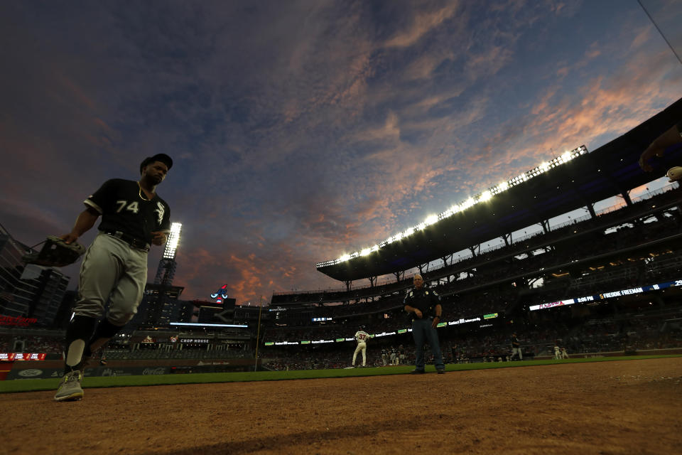 Chicago White Sox left fielder Eloy Jimenez walks to the dugout after being replaced in the eighth inning of a baseball game against the Atlanta Braves Sunday, Sept. 1, 2019, in Atlanta. The Braves won 5-3. (AP Photo/John Bazemore)