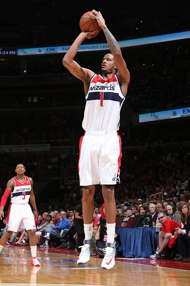 Washington, DC- APRIL 27: Trevor Ariza #1 of the Washington Wizards takes a shot against the Chicago Bulls during Game Four of the Eastern Conference Quarterfinals on April 27, 2014 at Verizon Center in Washington, DC. (Photo by Ned Dishman/NBAE via Getty Images)