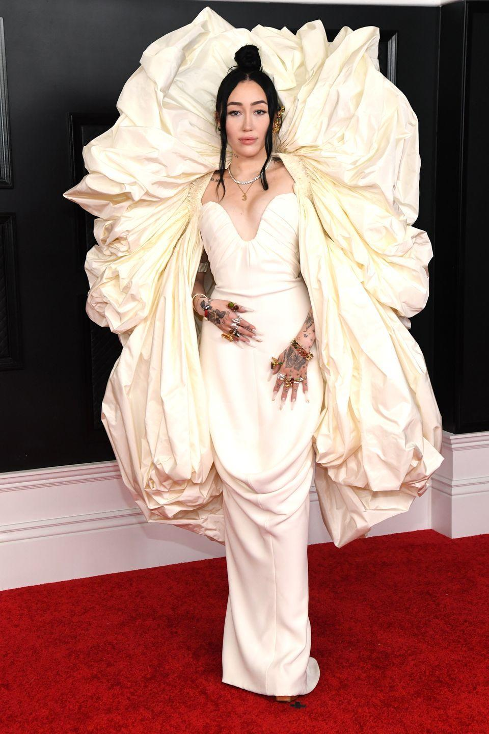 <p>The younger sister of Miley Cyrus – who has made a name for herself on the red carpet – made sure to stand out at the Grammys wearing a striking Schiaparelli haute couture ballgown.</p>