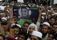 Supporters of a religious group chant slogan during a rally favoring the Khalid Khan, who gunned down Tahir Naseem in courtroom, in Peshawar, Pakistan, Friday, July 31, 2020. Naseem, a U.S. citizen, according to a U.S. State Department statement, was gunned down this week in a Pakistani courtroom while standing trial on a charge of blasphemy. (AP Photo/Muhammad Sajjad)