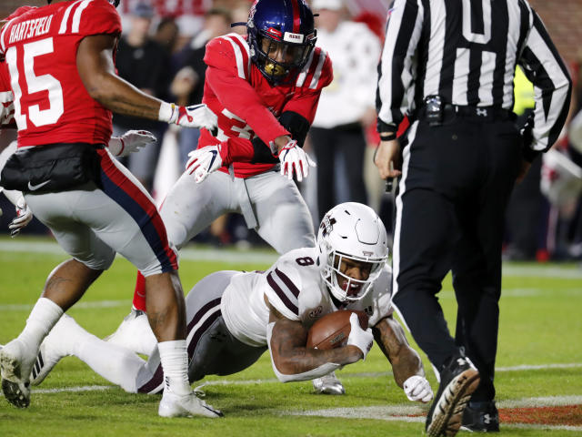 Mississippi State and Ole Miss got into it during the Egg Bowl. (AP Photo)