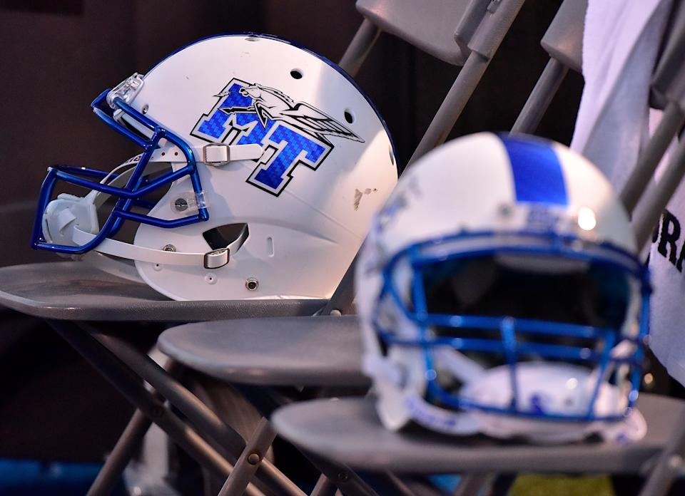 MURFREESBORO, TENNESSEE - SEPTEMBER 02:  A helmet of the Middle Tennessee State University Blue Raiders rests on the sideline during a 28-6 loss to the Vanderbilt Commodores at Floyd Stadium on September 2, 2017 in Murfreesboro, Tennessee.  (Photo by Frederick Breedon/Getty Images)