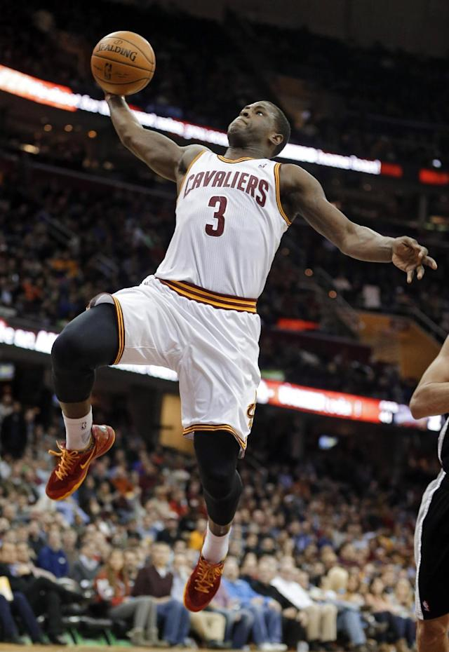 Cleveland Cavaliers' Dion Waiters (3) goes up for a dunk against the San Antonio Spurs during the second quarter of an NBA basketball game Tuesday, March 4, 2014, in Cleveland. (AP Photo/Mark Duncan)