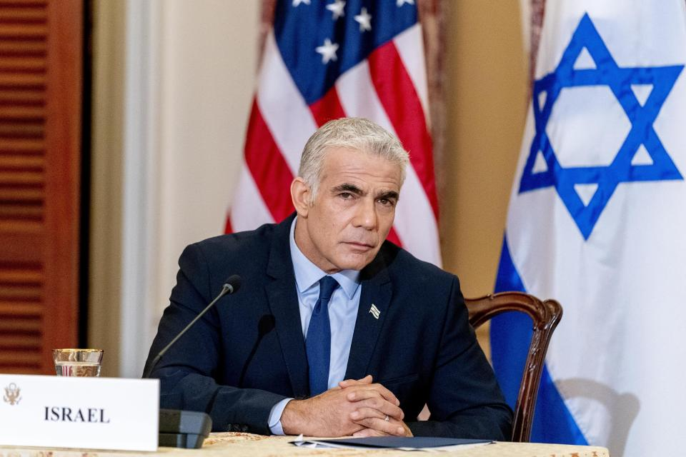 Israeli Foreign Minister Yair Lapid appears at a news conference with Secretary of State Antony Blinken and United Arab Emirates Foreign Minister Sheikh Abdullah bin Zayed al-Nahyanin, at the State Department in Washington, Wednesday, Oct. 13, 2021. (AP Photo/Andrew Harnik, Pool)