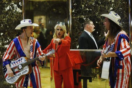 """Kellyanne Conway, campaign manager and senior advisor to the Trump Presidential Transition Team, converses with """"Naked Cowboy"""" themed street performers in the lobby at Trump Tower in New York, U.S., November 28, 2016. REUTERS/Lucas Jackson"""