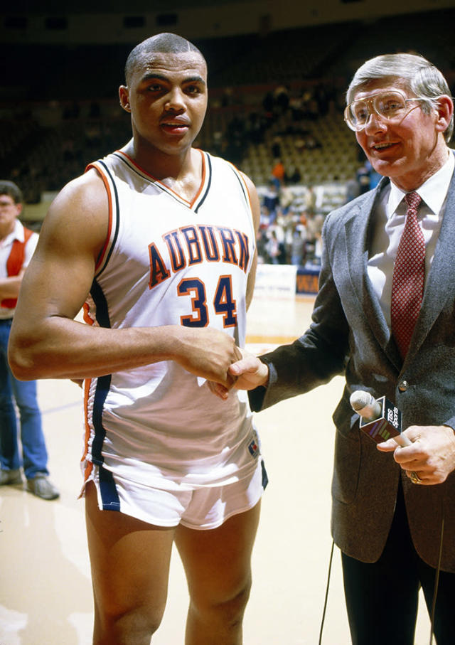 University of Auburn's Center Charles Barkley #34 shakes hands with a reporter following a circa 1980s game. (Photo by Focus on Sport/Getty Images)