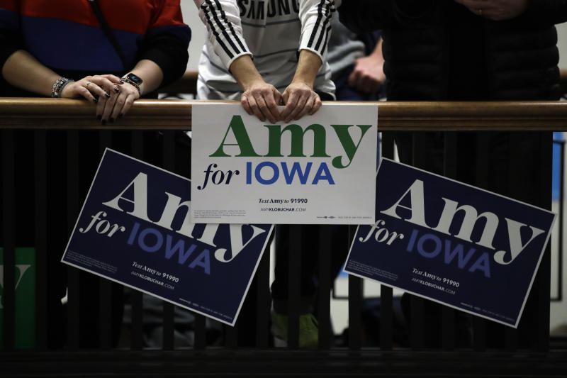 Supporters of Democratic presidential candidate Sen. Amy Klobuchar, D-Minn., hold signs as they hear her speak during a campaign event in the historic Northwestern Hotel building Sunday, Jan. 26, 2020, in Des Moines, Iowa. (AP Photo/Marcio Jose Sanchez)