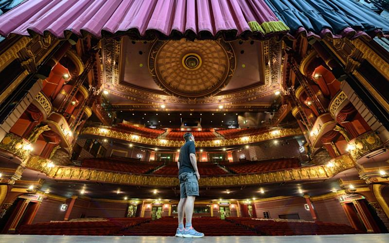 Steve Clarkson, head of maintenance, inspects the empty Palace Theatre in Manchester - Oli Scarff/AFP via Getty Images