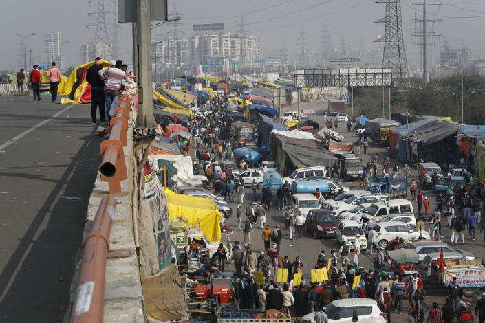 Farmers arrive at Delhi-Uttar Pradesh border to protest against new farm laws, at the Delhi-Uttar Pradesh border, on the outskirts of New Delhi, India, Saturday, Jan. 30, 2021. Indian farmers and their leaders spearheading more than two months of protests against new agriculture laws began a daylong hunger strike Saturday, directing their fury toward Prime Minister Narendra Modi and his government. Farmer leaders said the hunger strike, which coincides with the death anniversary of Indian independence leader Mahatma Gandhi, would reaffirm the peaceful nature of the protests. (AP Photo/Manish Swarup)