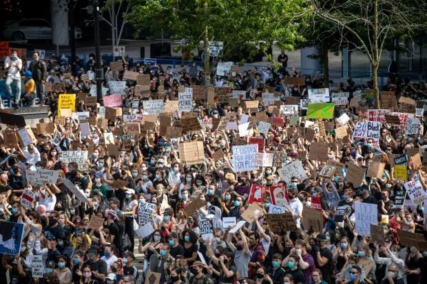People are pictured during the Black Lives Matter rally in Vancouver, British Columbia on Friday, June 5, 2020.
