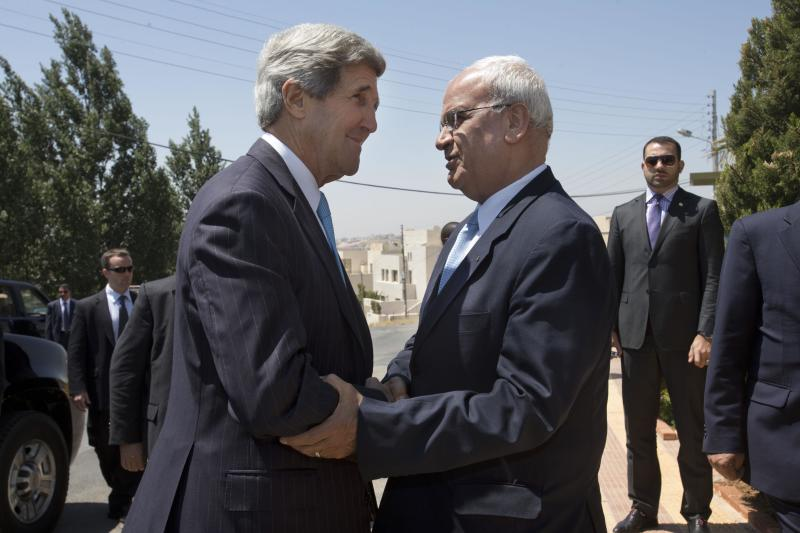 U.S. Secretary of State John Kerry, left, is greeted by Saeb Erekat, Palestinian chief negotiator, as Kerry arrives for his meeting with Palestinian President Mahmoud Abbas, not pictured, for their second meeting in Amman, Jordan, on Saturday, June 29, 2013. Kerry held talks with Abbas on Saturday for the second time in two days, continuing his rushed round of shuttle diplomacy to restart talks between Israel and the Palestinians. (AP Photo/Jacquelyn Martin, Pool)