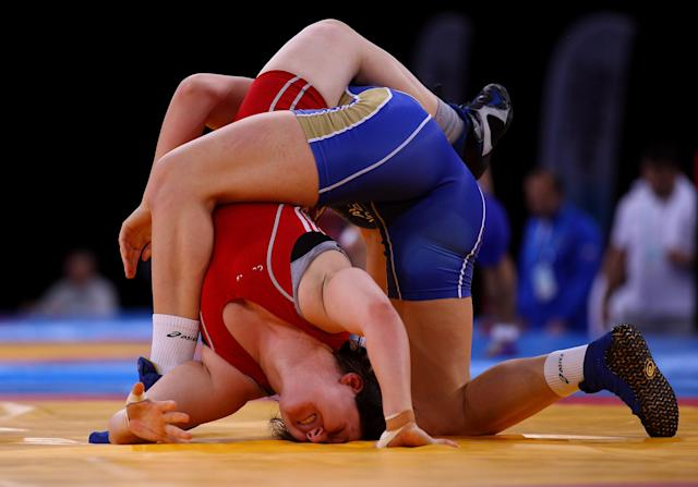LONDON, ENGLAND - DECEMBER 11: Chloe Spiteri of Great Britain is held by Ekaterine Bukina of Russia in the Women's Freestyle 72kg bout during the Wrestling LOCOG Test Event for London 2012 at ExCel on December 11, 2011 in London, England. (Photo by Warren Little/Getty Images)