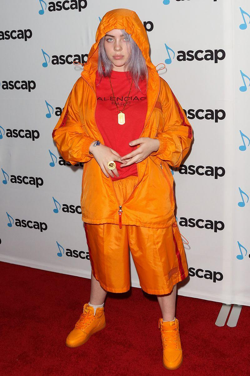 <p>Before neon green became her signature colour, Billie was often papped in highlighter-orange that contrasted with her lavender strands.</p>