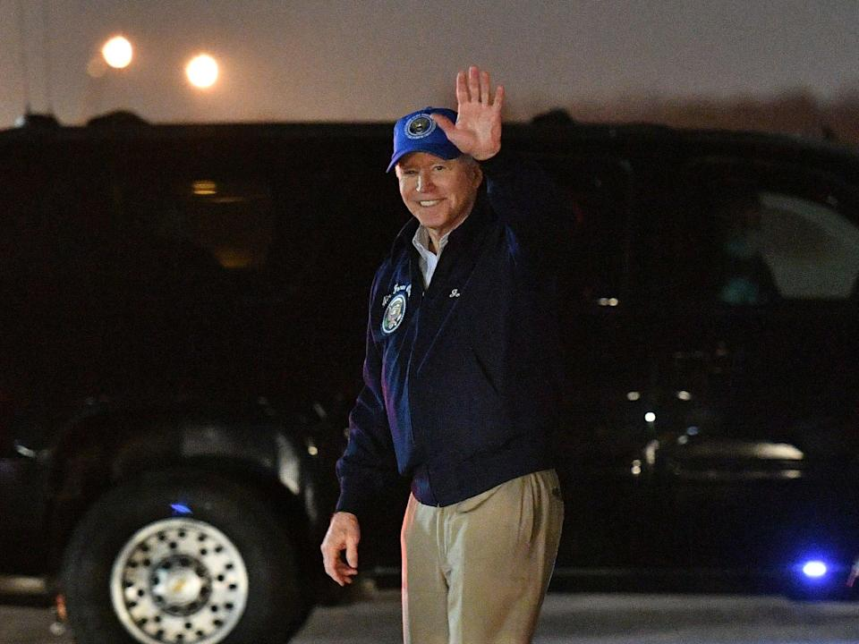 President Joe Biden waves upon arrival at Andrews Air Force Base in Maryland on February 26, 2021. (AFP via Getty Images)