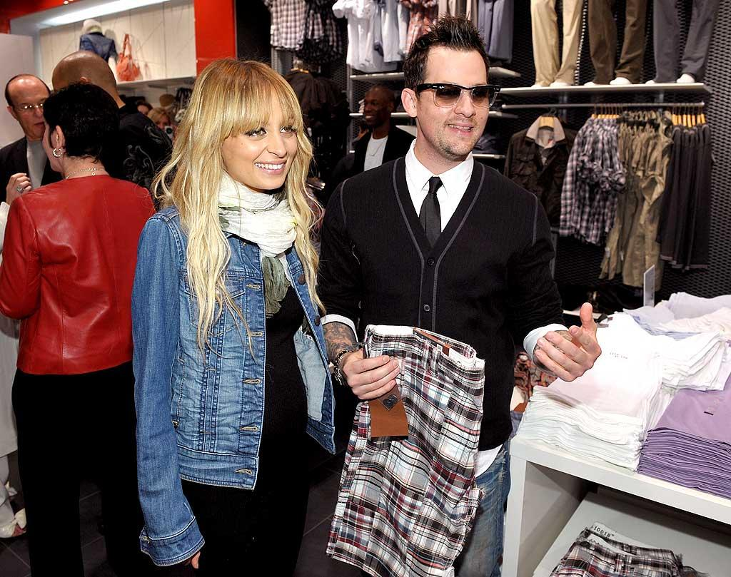 "Nicole Richie and Joel Madden get their shop on at the grand opening of the new Esprit store in Santa Monica, California. Looks like they found Joel the perfect pair of madras shorts! John Shearer/<a href=""http://www.wireimage.com"" target=""new"">WireImage.com</a> - April 2, 2009"