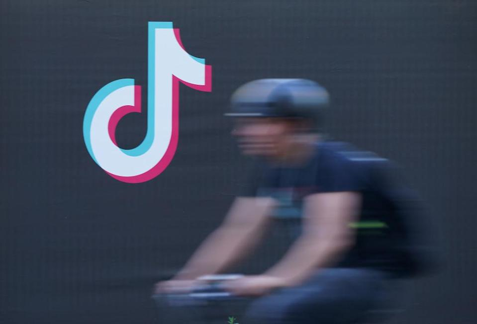BERLIN, GERMANY - SEPTEMBER 21: A bicyclist rides past an advertisement for social media company TikTok on September 21, 2020 in Berlin, Germany. U.S. President Donald Trump has given preliminary approval for Oracle, Walmart and other investors to take over TikTok and create a new U.S.-based company called TikTok Global. (Photo by Sean Gallup/Getty Images)