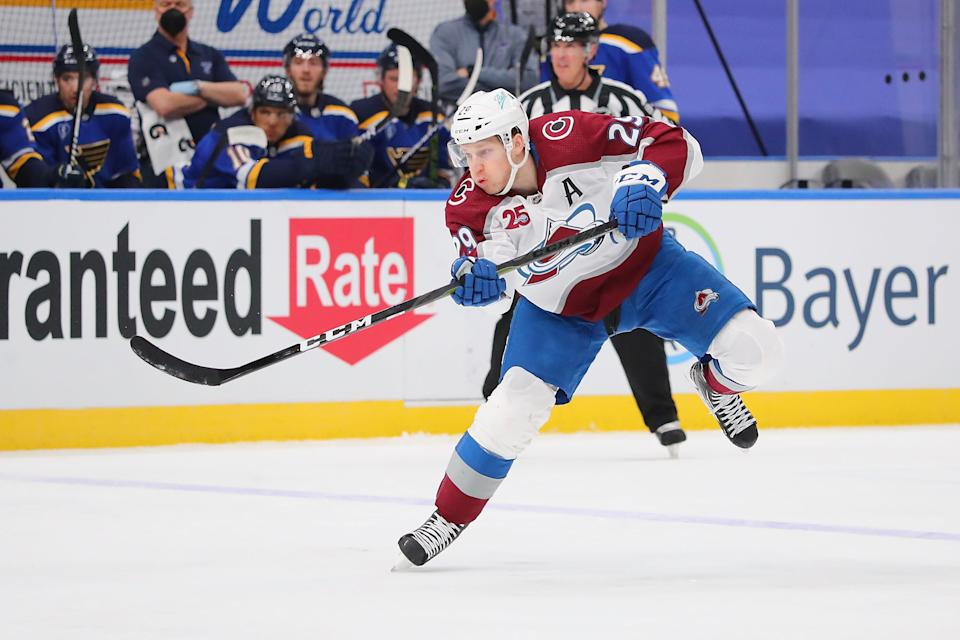 ST LOUIS, MO - APRIL 22:  Nathan MacKinnon #29 of the Colorado Avalanche shoots the puck against the St. Louis Blues at Enterprise Center on April 22, 2021 in St Louis, Missouri. (Photo by Dilip Vishwanat/Getty Images)