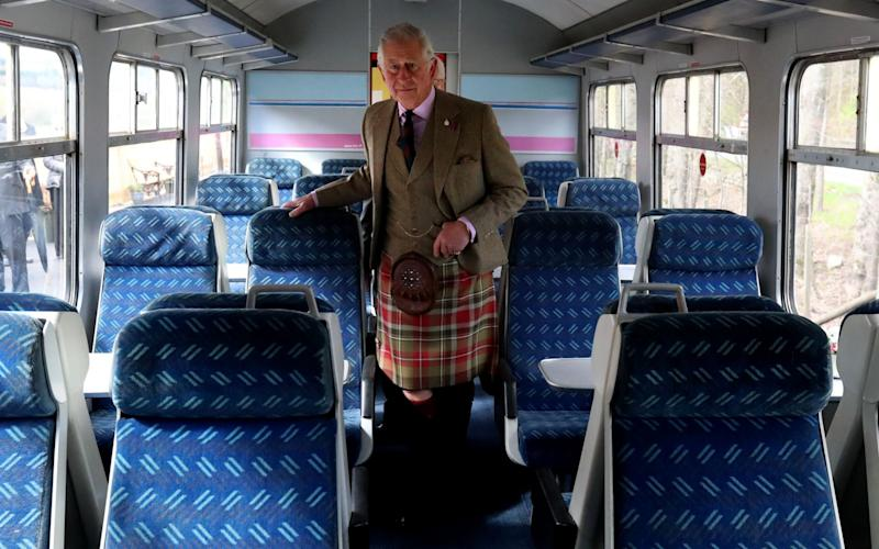 Prince Charles views the inside of the restored carriages that were vandalised in August 2015 - Credit: Andrew Milligan/PA