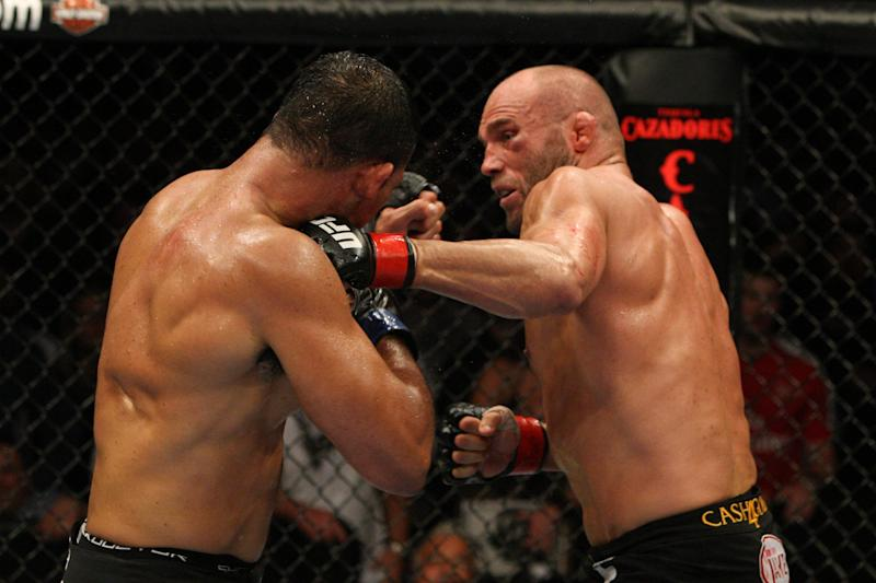 "PORTLAND, OR - AUGUST 29: Antonio Rodrigo ""Minotauro"" Nogueira (white shorts) def. Randy Couture (black shorts) - Unanimous Decisio at the Rose Garden on August 29, 2009 in Portland, Oregon. (Photo by Josh Hedges/Zuffa LLC via Getty Images)"